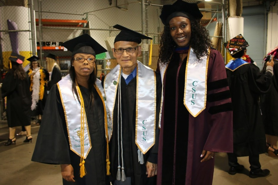 Rodolfo Castillo joins instructor Idara Essien-Wood and classmate Glinda Copridge for a final photo after their commencement ceremony at Sleep Train Arena. (College of Continuing Education/Sharon Ito)